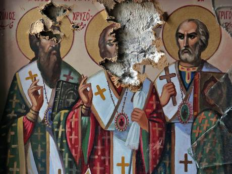 Damaged icons inside the church of the monastery of Saint Takla in the ancient Christian town of Maalula, 56km from Damascus (Getty)