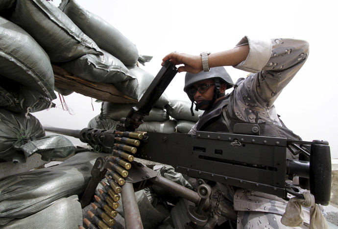 A Saudi soldier loads ammunition at their position at Saudi Arabia' class=