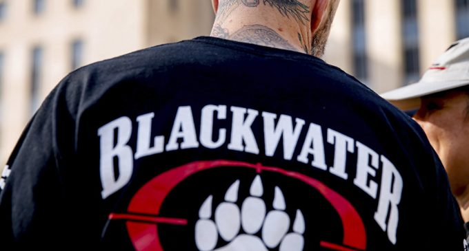 A former member of Blackwater joines family members, friends, and supporters of four former Blackwater security guards outside the federal court in Washington, Monday, April 13, 2015'Nonsense': Kremlin Denies Representative of Putin Met With Blackwater Founder