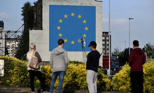Banksy's Chipping at EU Flag Brexit Mural Vandalized by Local Resident