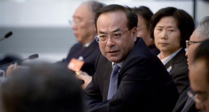 China's ex-Politburo member charged with bribery