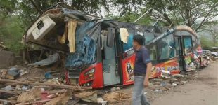 18 dead as Thai tour bus loses control, crashes off road