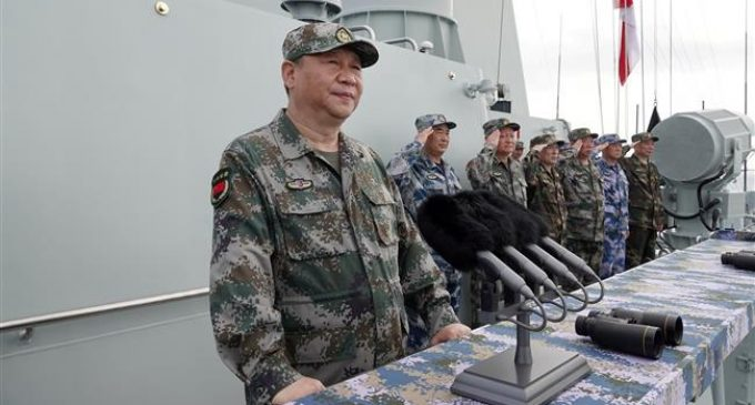 China's Xi attends huge naval drill in South China Sea