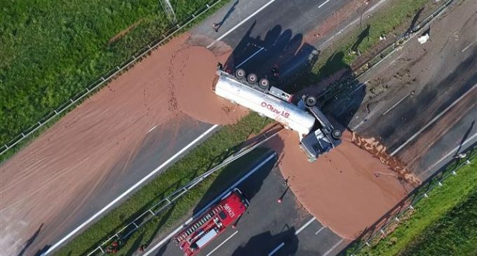 Liquid chocolate spill from truck accident leaves Polish highway a sticky mess