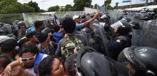 1000 of US-bound Honduran migrants storm Guatemala border into Mexico