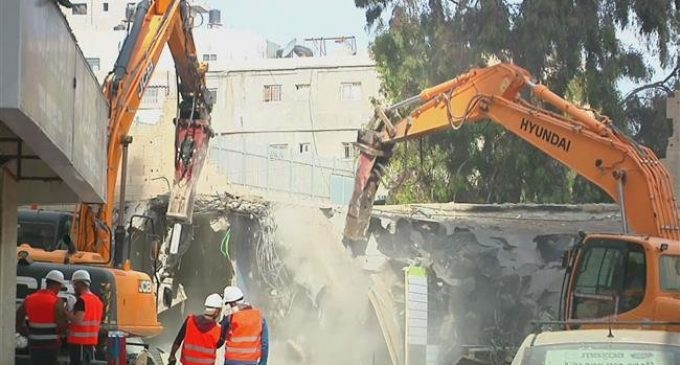 Israel demolishes shops at refugee camp in occupied al-Quds
