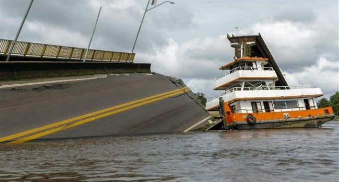 Bridge struck by boat collapses into river in northern Brazil