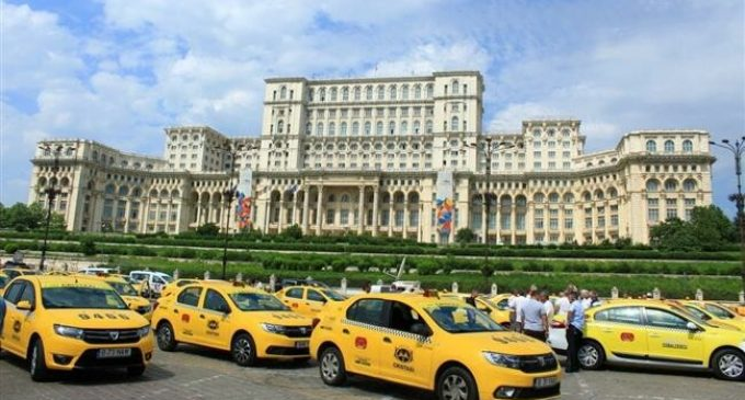 Romania taxi drivers protest against Uber