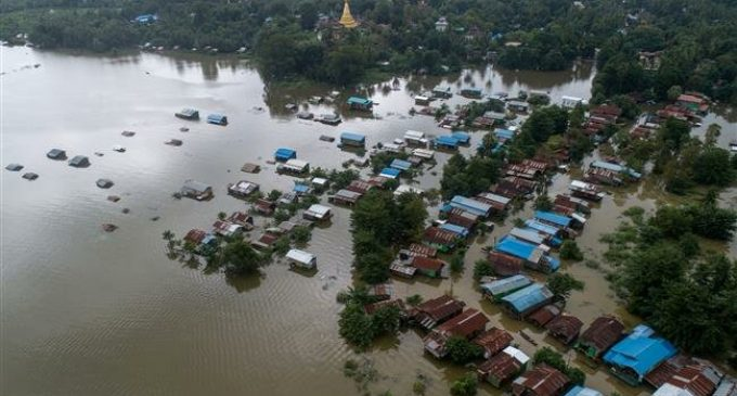 Myanmar floods force tens of thousands from homes