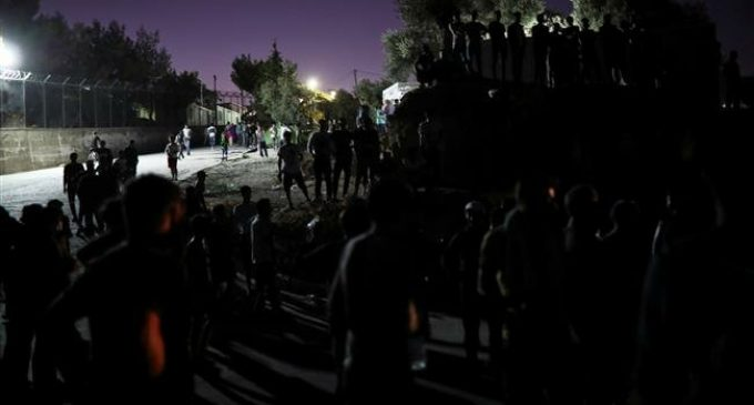 Woman, child dead in fire at migrant camp in Greek island