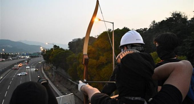 Protesters in Hong Kong now firing arrows at police
